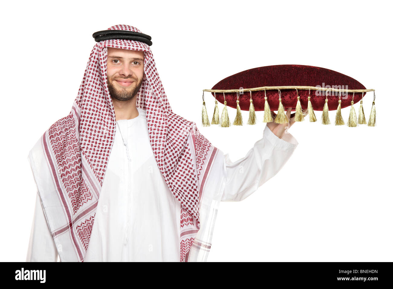 An arab person holding a pillow Stock Photo