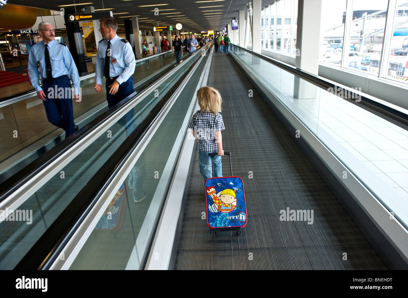 Three year old boy on his way to departure hall aT Schiphol Airport in Netherlands, Europe Stock Photo