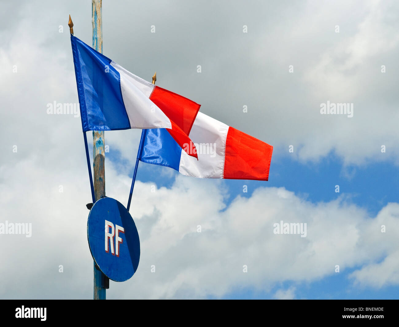 French Tricolour flags on flagpole. - Stock Image