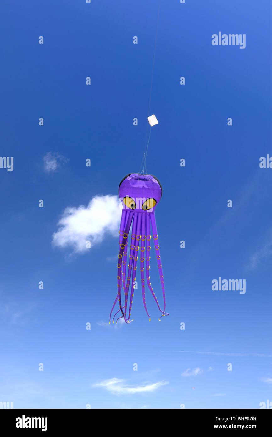 Purple Octopus kite flying - Stock Image