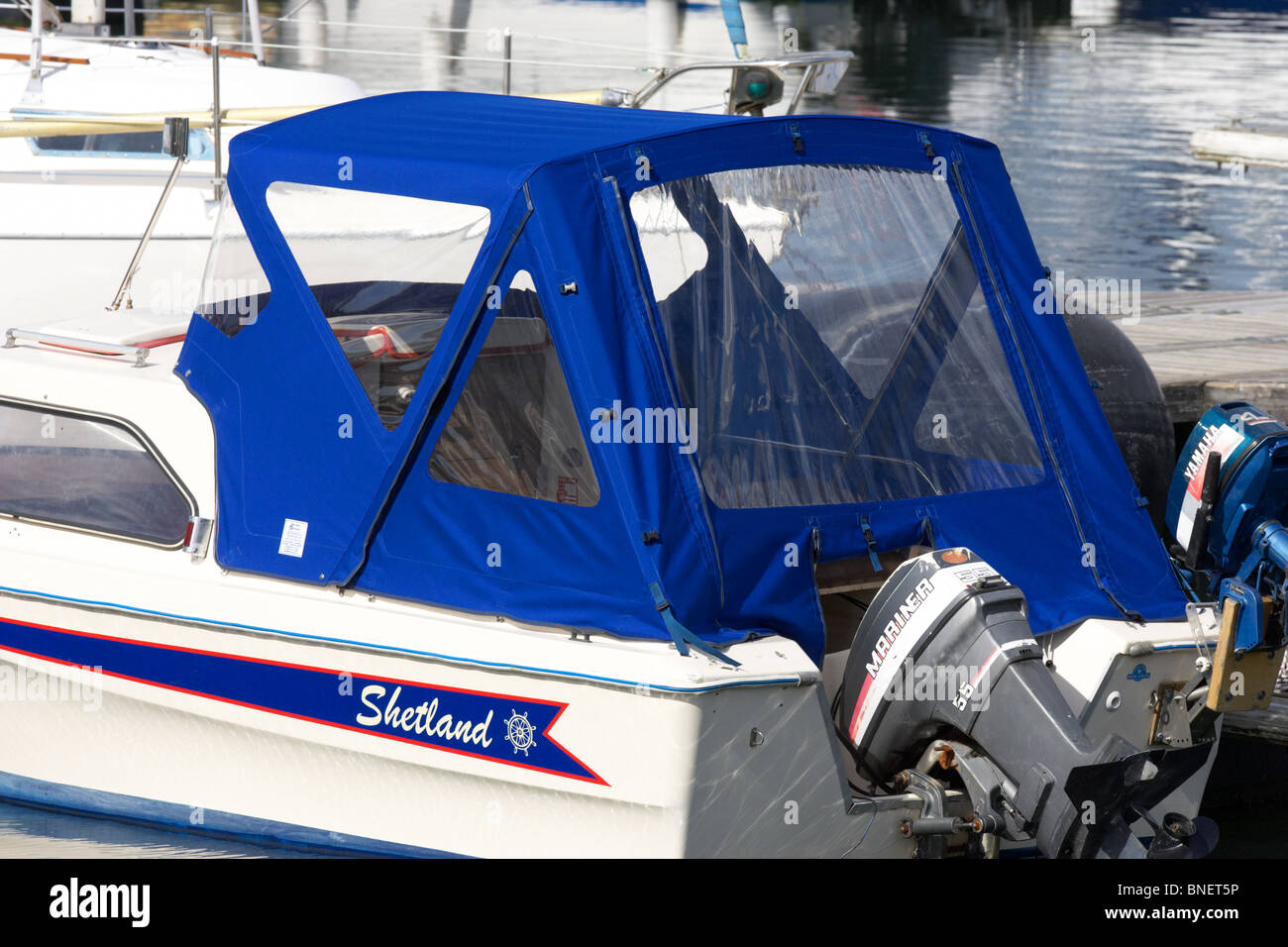 pram cover boat canopy covering shetland boat berthed in marina county down northern ireland uk - Stock Image