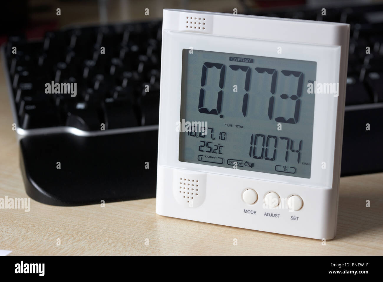 using a wireless electricity monitor to monitor electricity usage in a home office environment in the uk - Stock Image