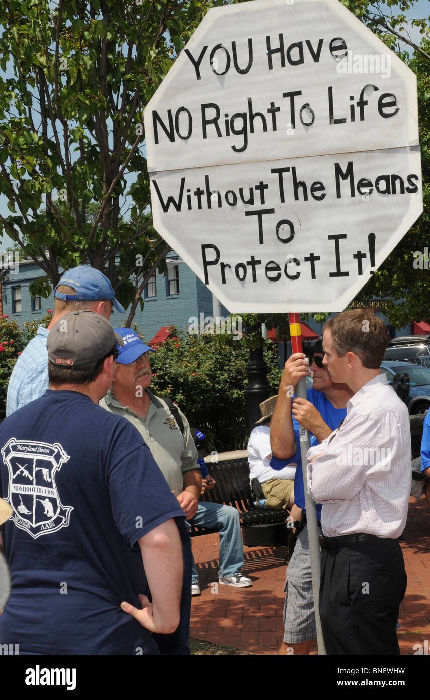 : Republican candidate for governor Brian Murphy listens to pro gun activists expressing their opinions in Annapolis, - Stock Image