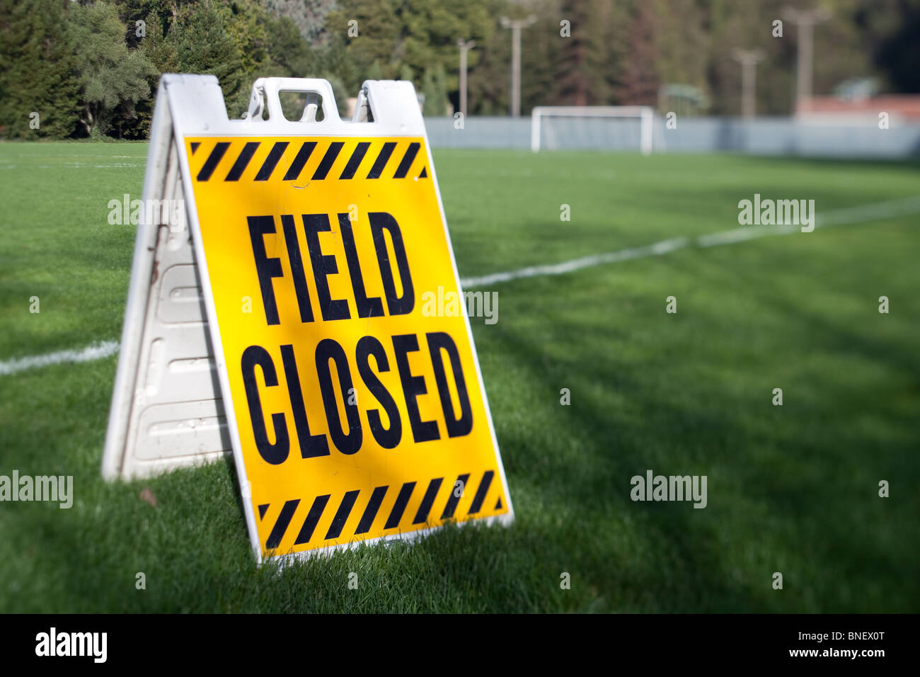 Field closed sign at a sports field. - Stock Image