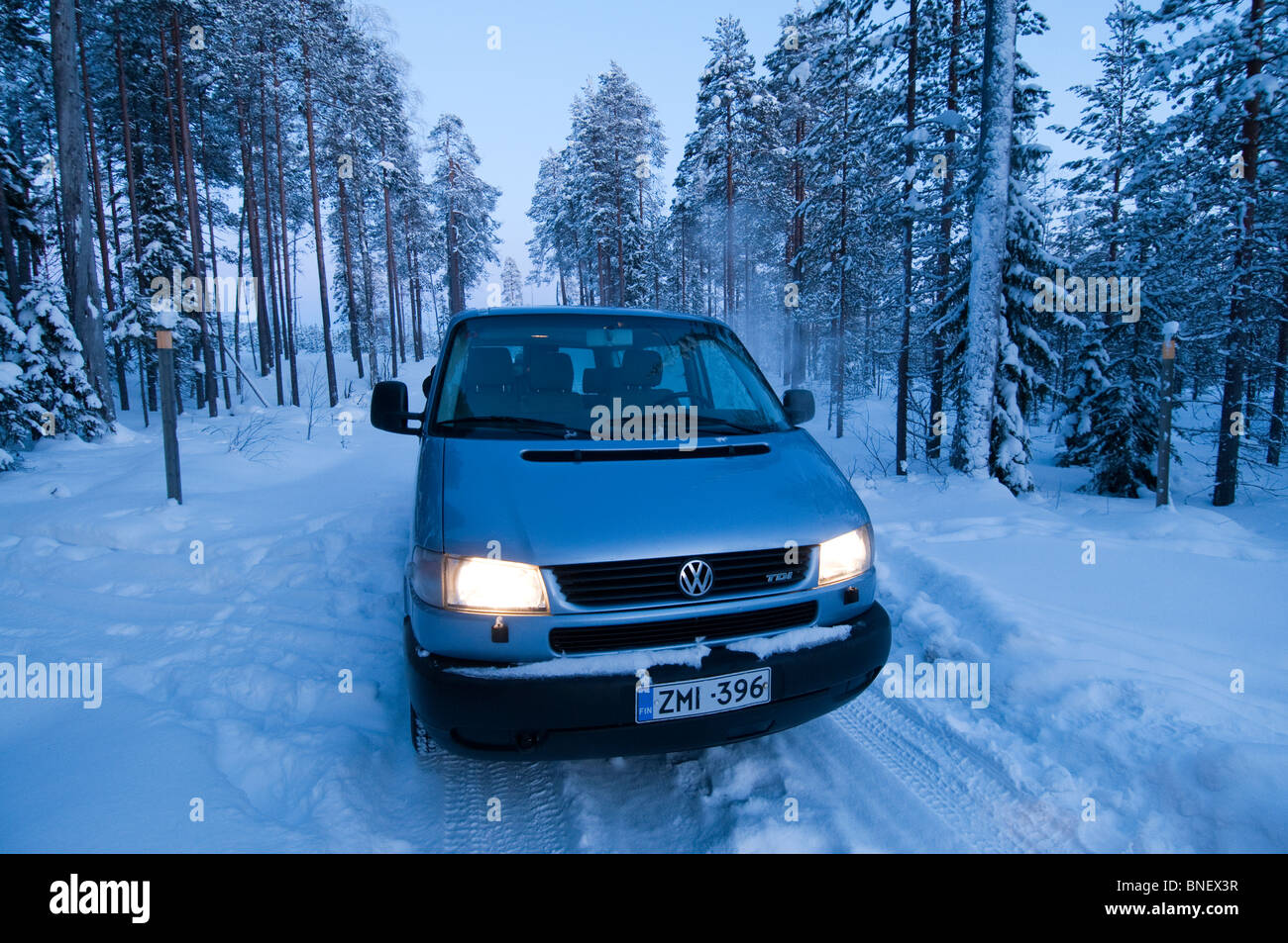 Van car crossing Taiga forest, Kuhmo, Finland, near the Russian border in February - Stock Image
