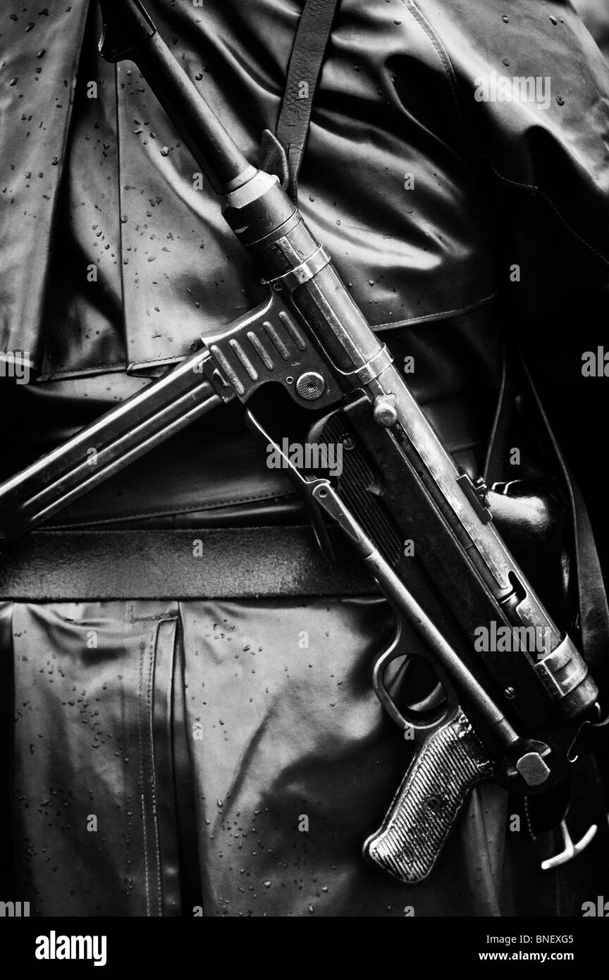 WW2 German army soldier carrying MP40 9 mm submachine gun. Historical re enactment. Monochrome - Stock Image