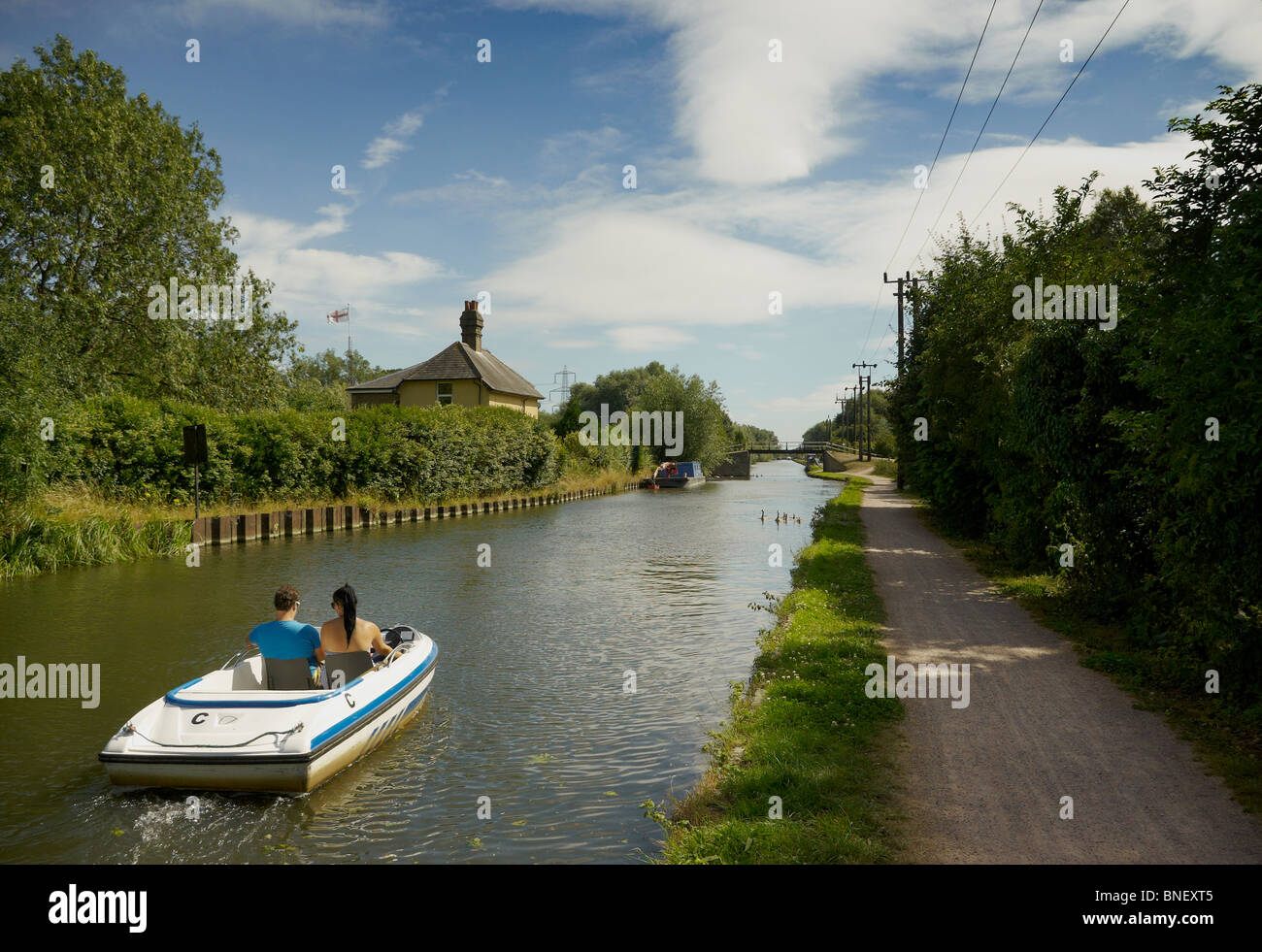 Small Motorboat on the River Lea Navigation Essex England - Stock Image