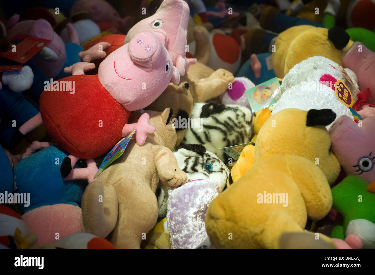 Close up of soft toys in arcade machine,Fisher-Price to make toy range with potential to bring in $1bn a year Peppa - Stock Image