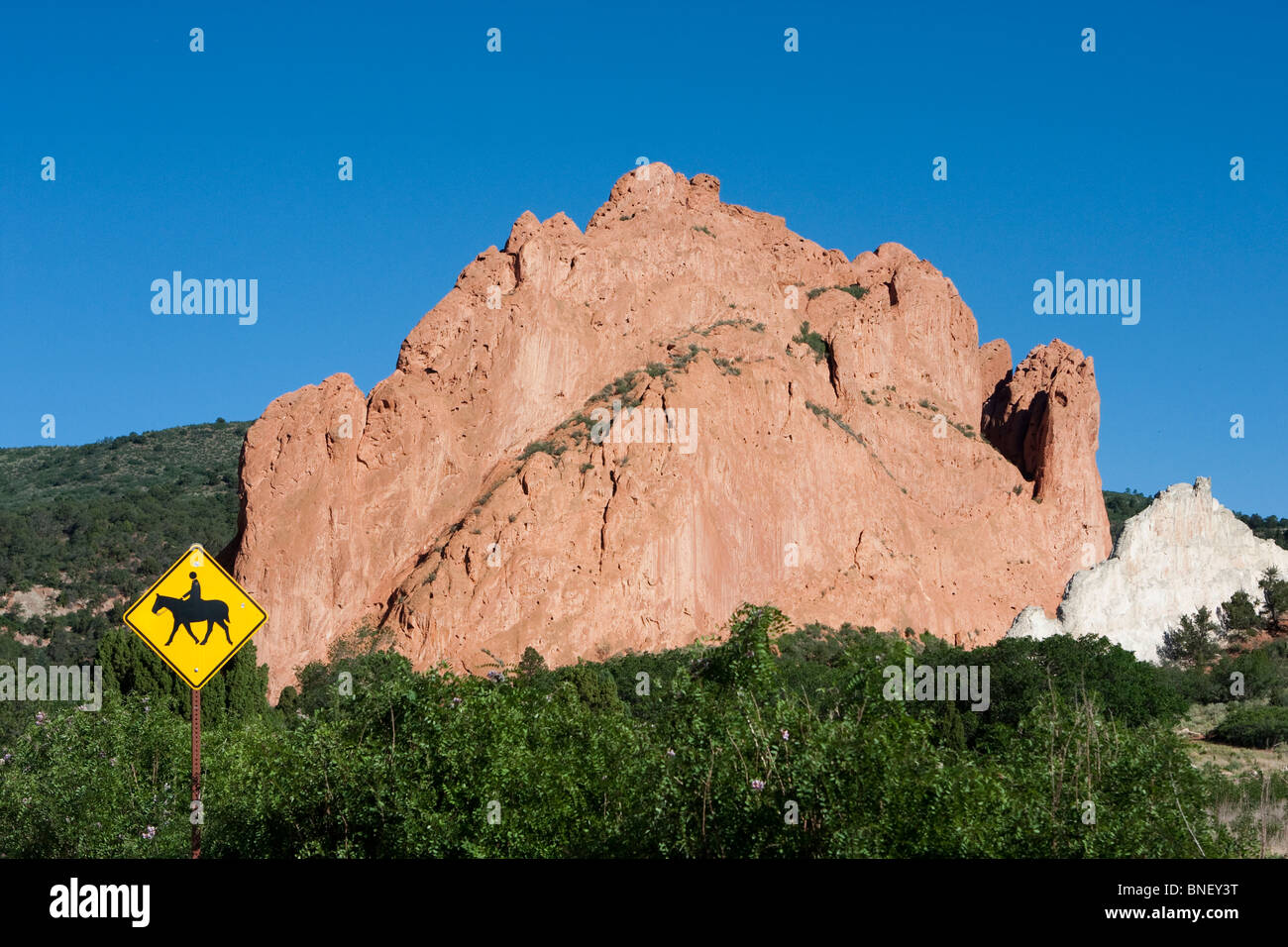 Garden of the Gods Colorado Red Rock formations road horse crossing sign - Stock Image