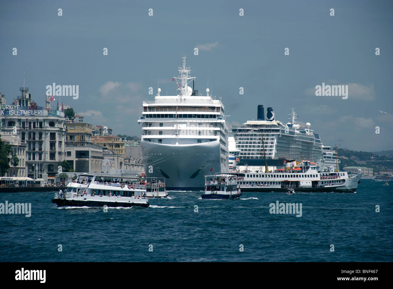 Cruise ships and ferries near Karakoy in Istanbul, Turkey - Stock Image