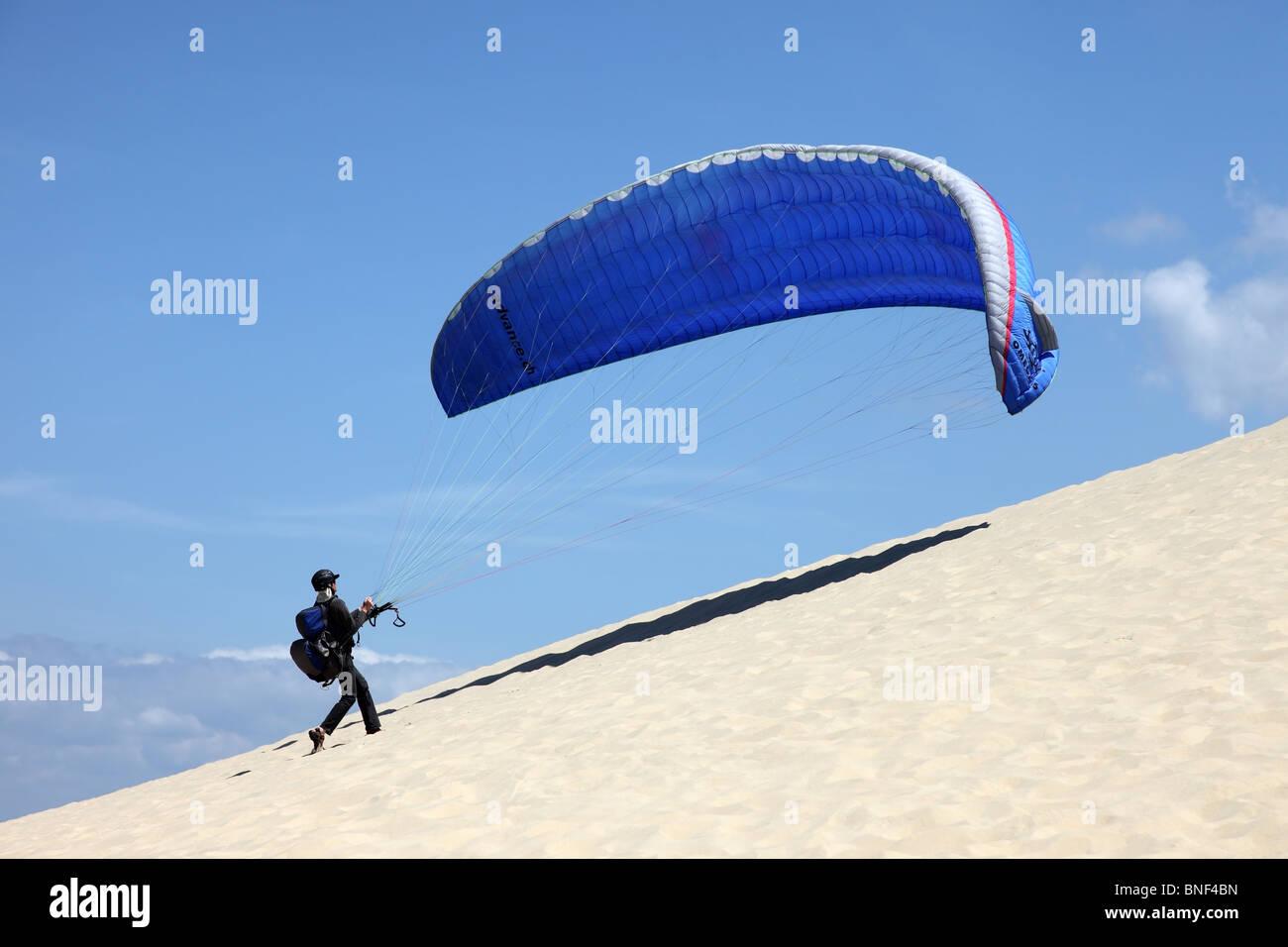 Paraglider Ascending the Dunes du Pyla Near Arachon France Stock Photo