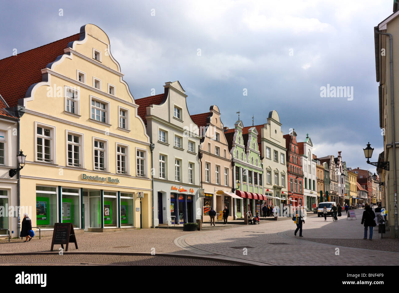 Renovated historical shop houses around the market square in Wismar, Germany - Stock Image