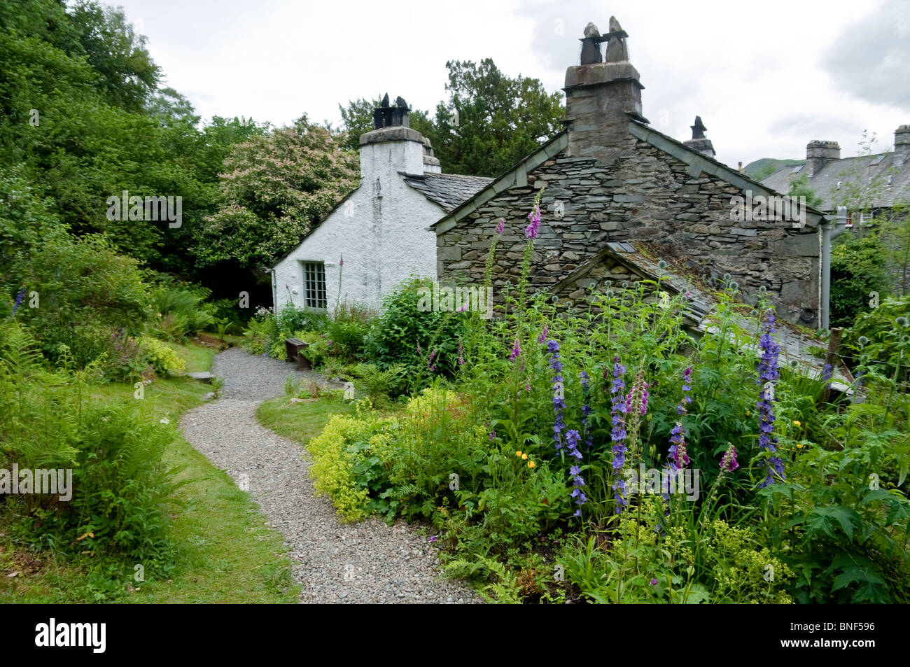 Dove Cottage garden - home to William Wordsworth, Town End, Nr Grasmere, The Lake District, Cumbria, UK - Stock Image
