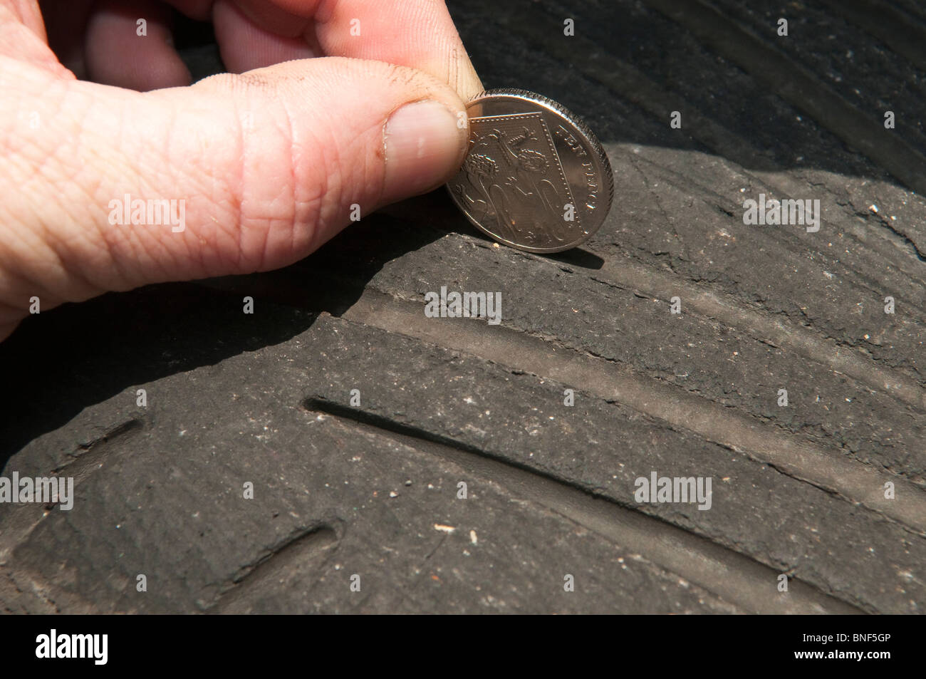 Illegal Car Tyre - Stock Image