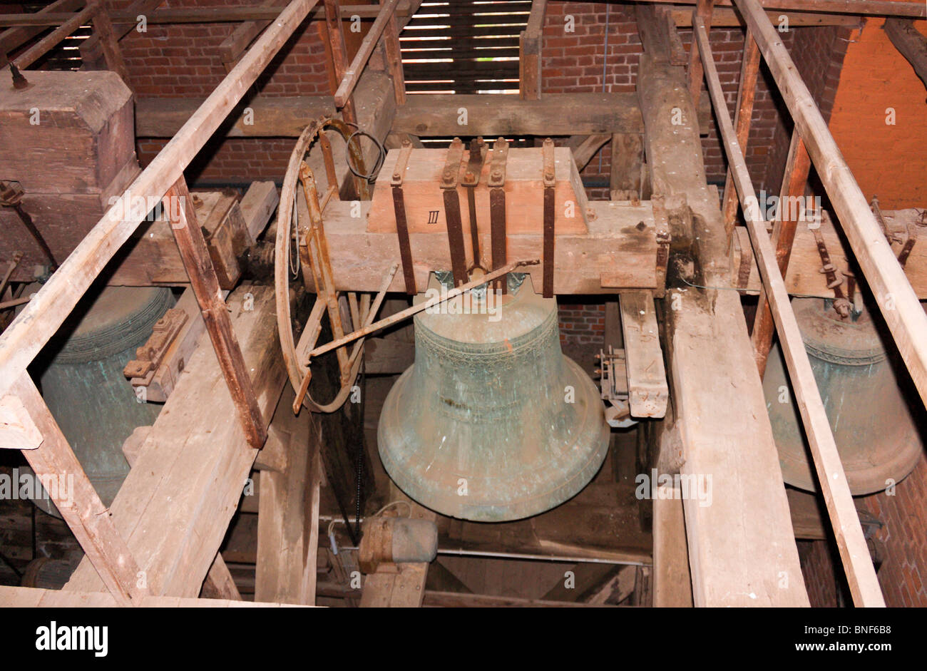 Church bell with wooden support structure, Wismar, Germany - Stock Image