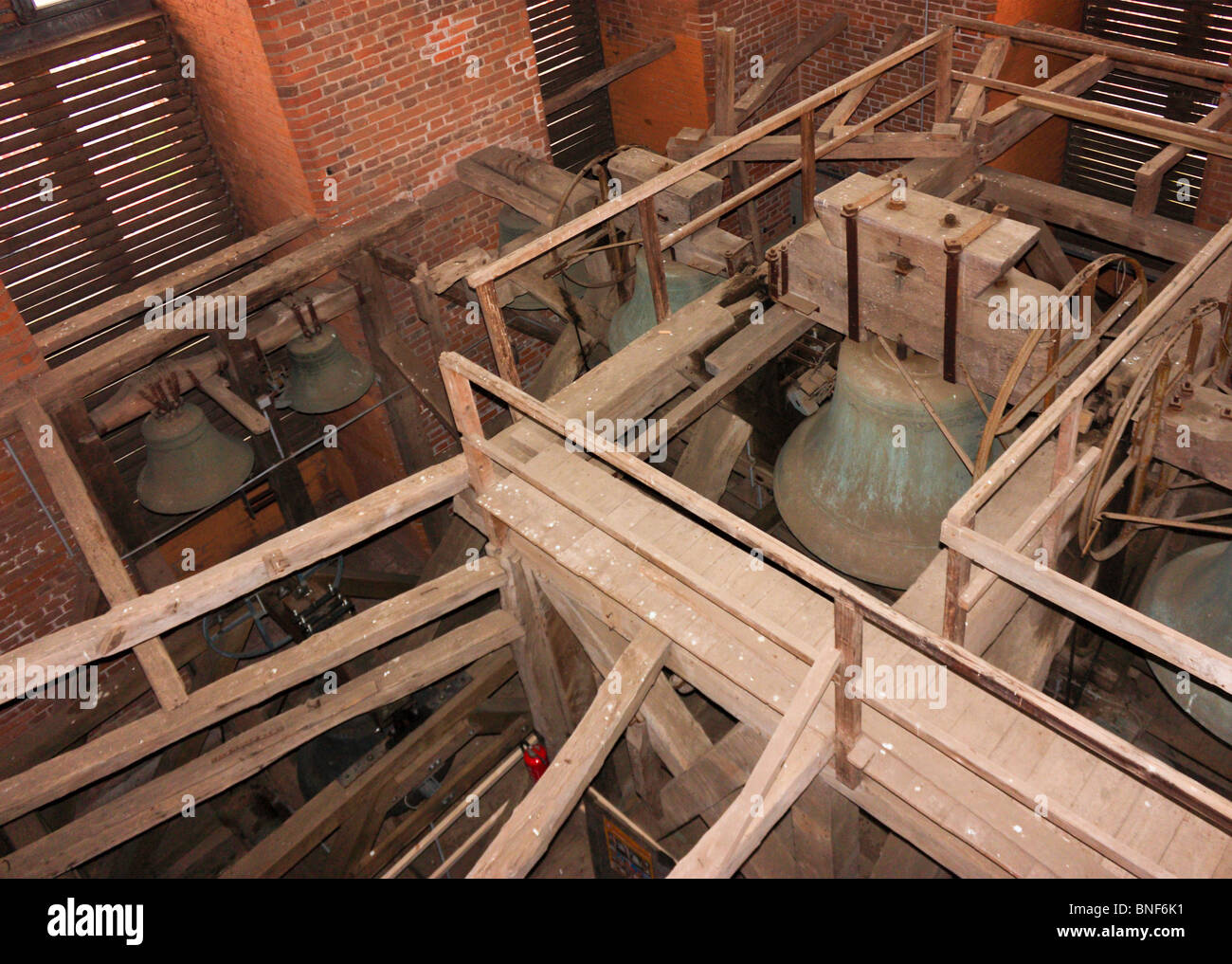 Church bells with wooden support structure, Wismar, Germany - Stock Image