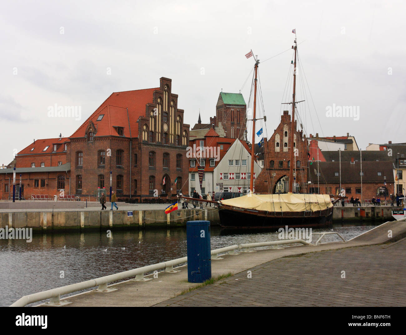 Old Harbour with historical warehouses in Wismar, Germany - Stock Image