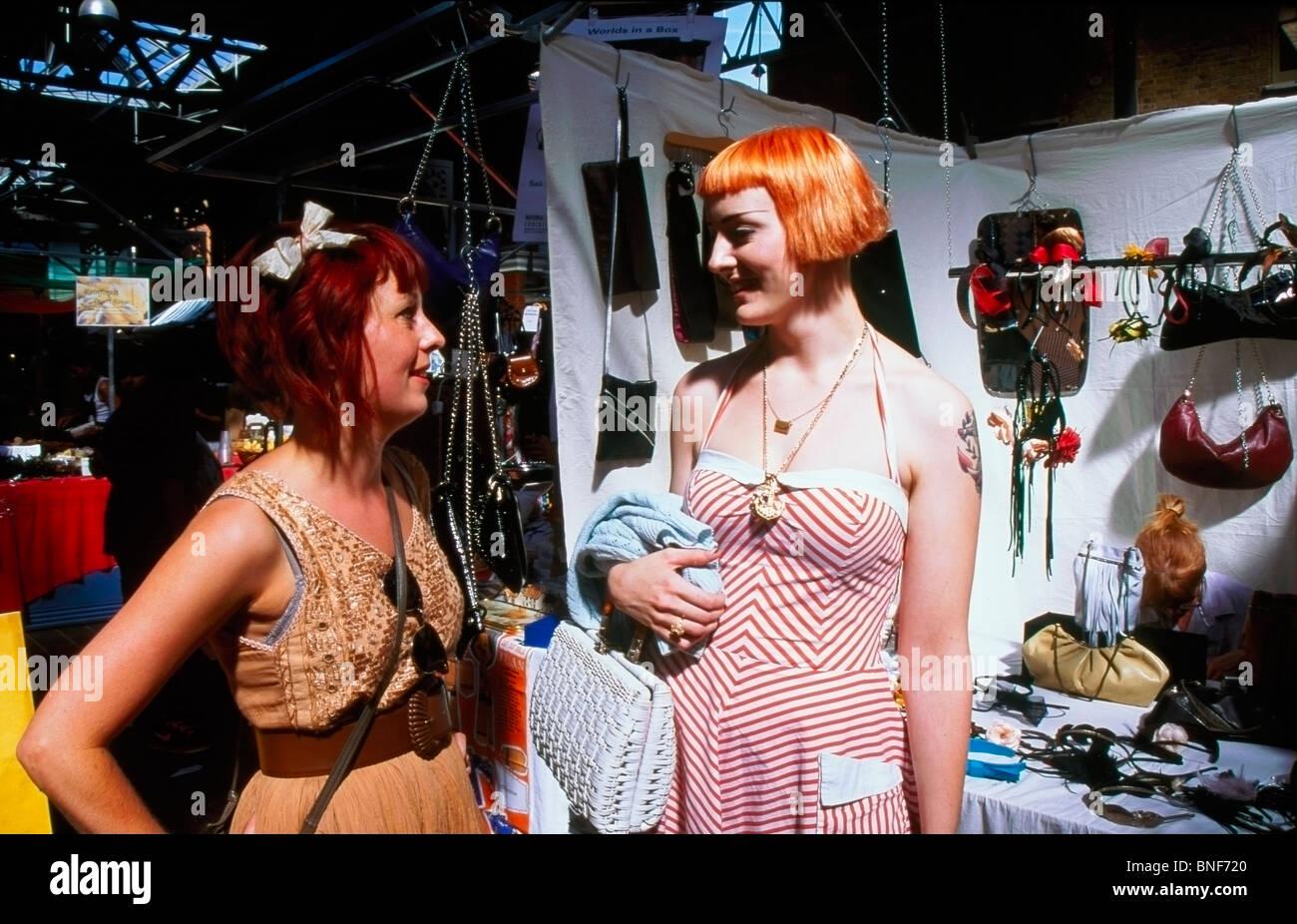 Two fashionable young women in Spitalfields Sunday Market London England UK - Stock Image