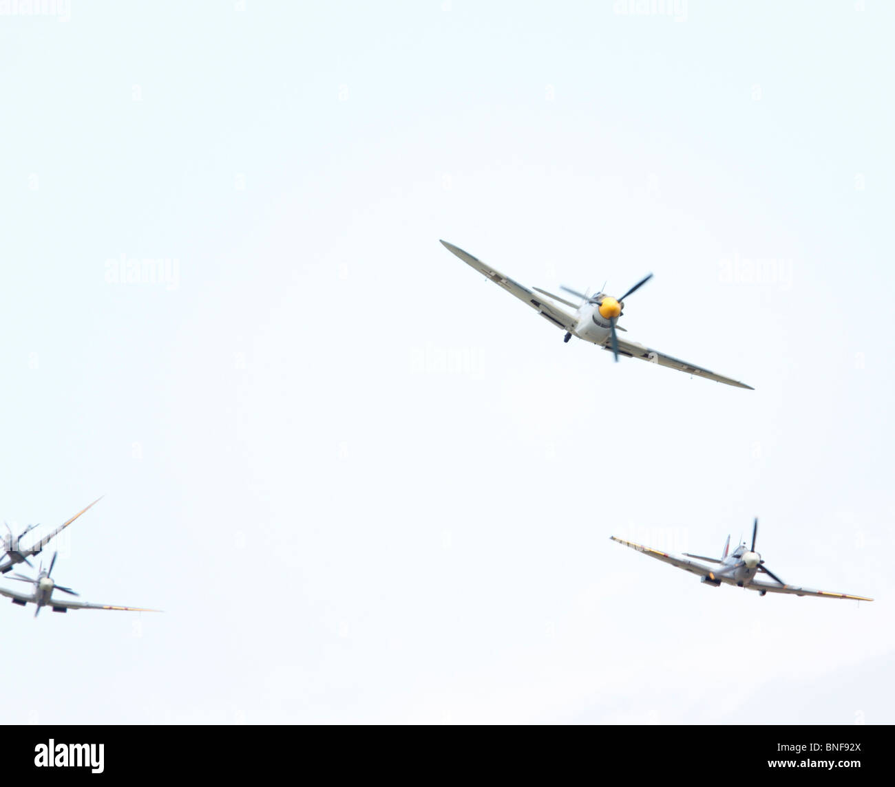 Messerschmidt Me109, being chased by Spitfires. Lincoln, International Airshow. This is actually a Hispano Aviacion - Stock Image