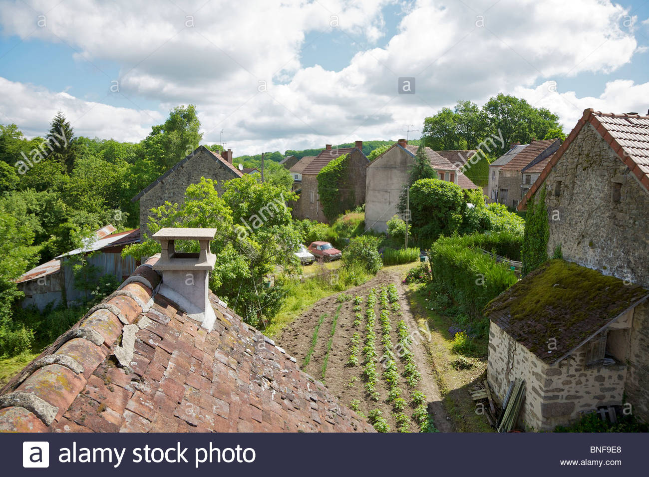 View from the rooftop of a small farmhouse in a rural French village. Les Verrines, La Creuse, Limousin, France. - Stock Image