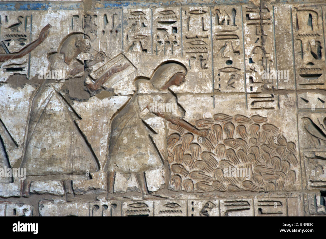 Temple of RamsesIII. Officials counting the severed hands of enemies killed in action to know the casualties in - Stock Image