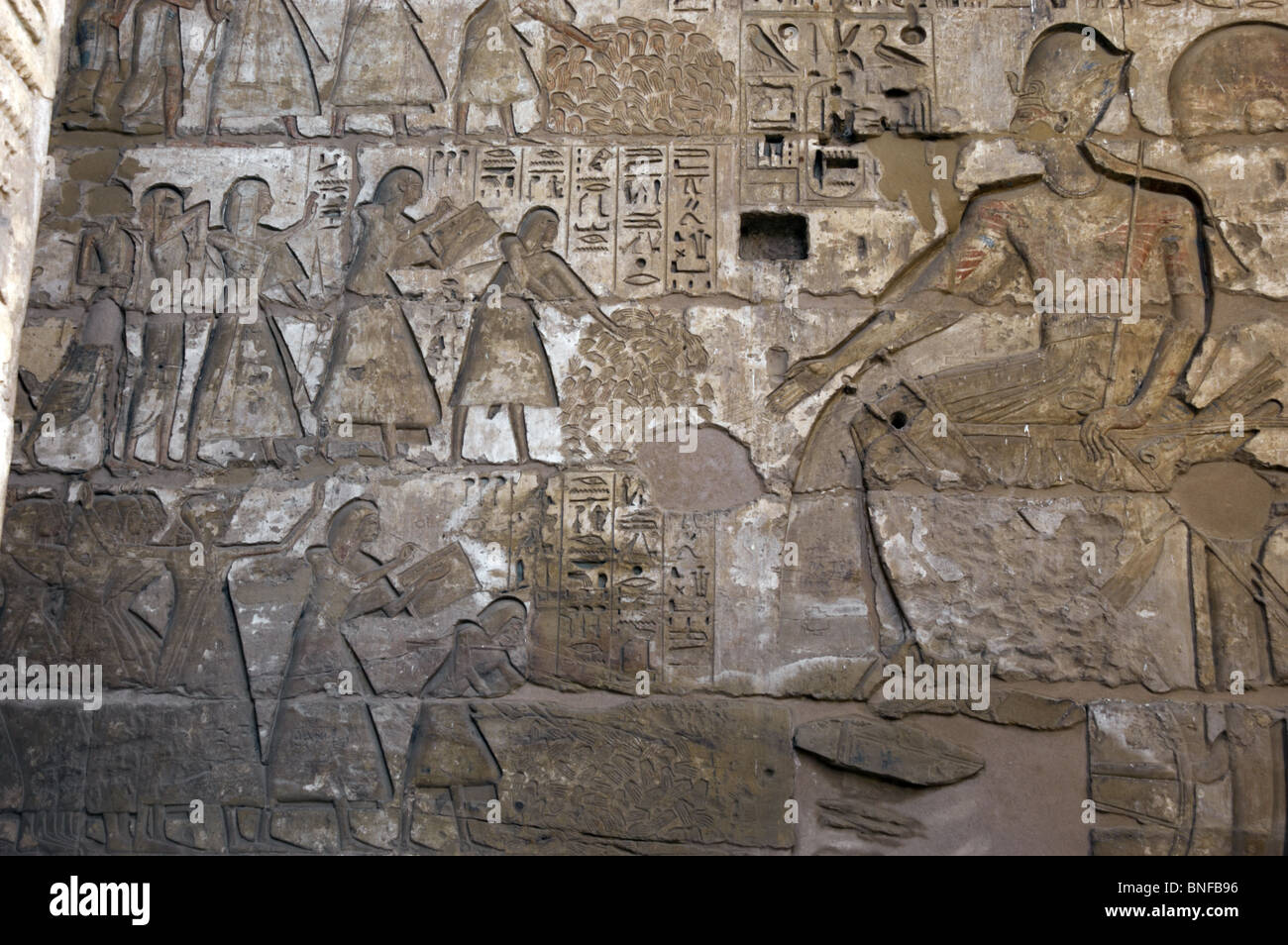Temple of Ramses III. Officials before Ramses III counting the hands of enemies killed in action to know the enemy - Stock Image