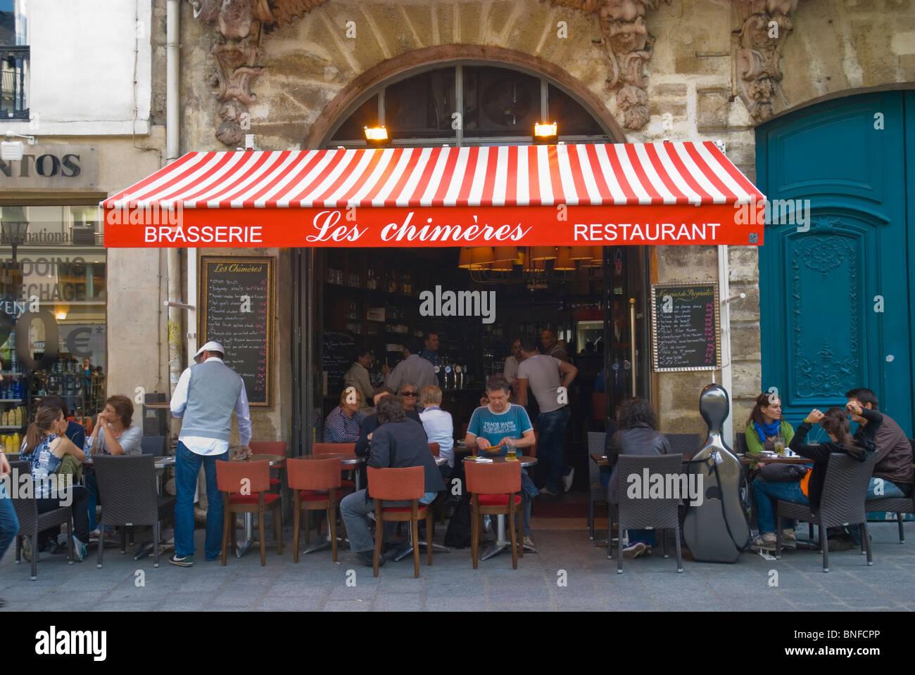 Brasserie Les Chimeres Rue Saint Antoine Le Marais district Paris France Europe - Stock Image