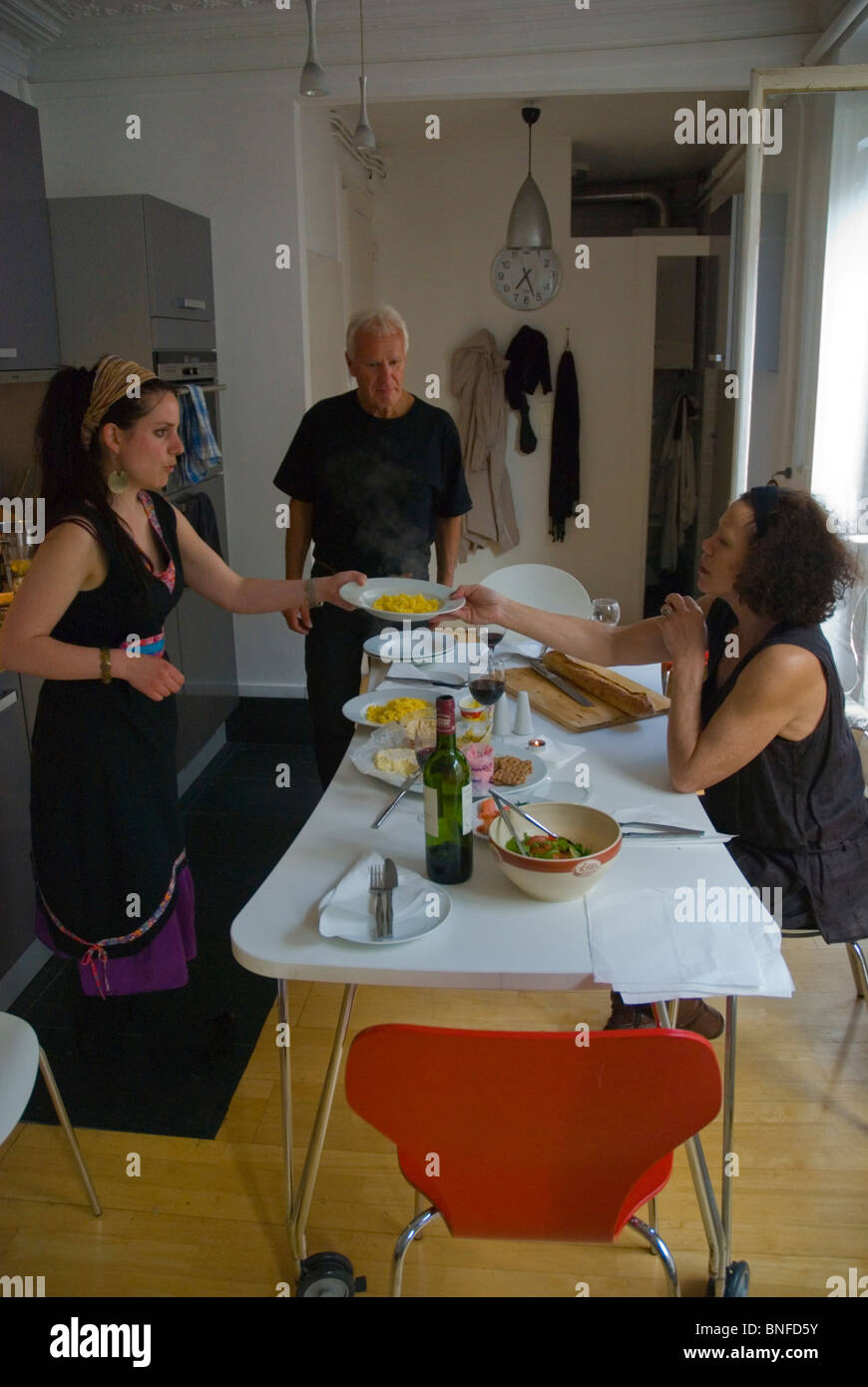 Australian having a meal in a private flat in central Paris France Europe - Stock Image