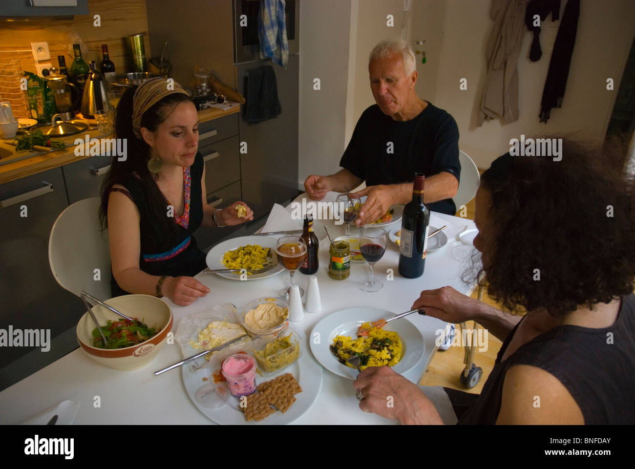 Australian family having a meal in an apartment in Le Marais district Paris France Europe - Stock Image