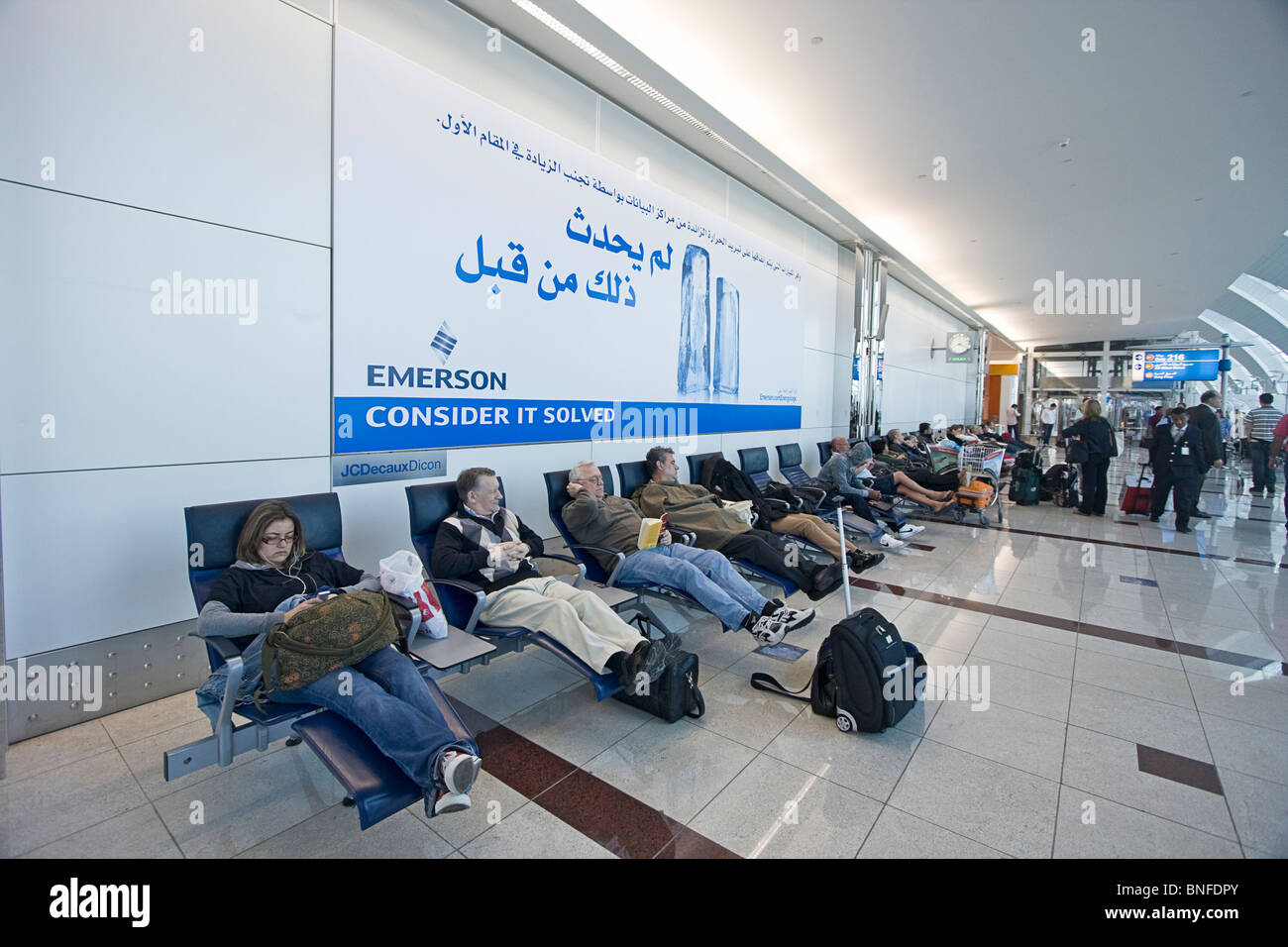 Travellers resting on reclining chairs at Dubai