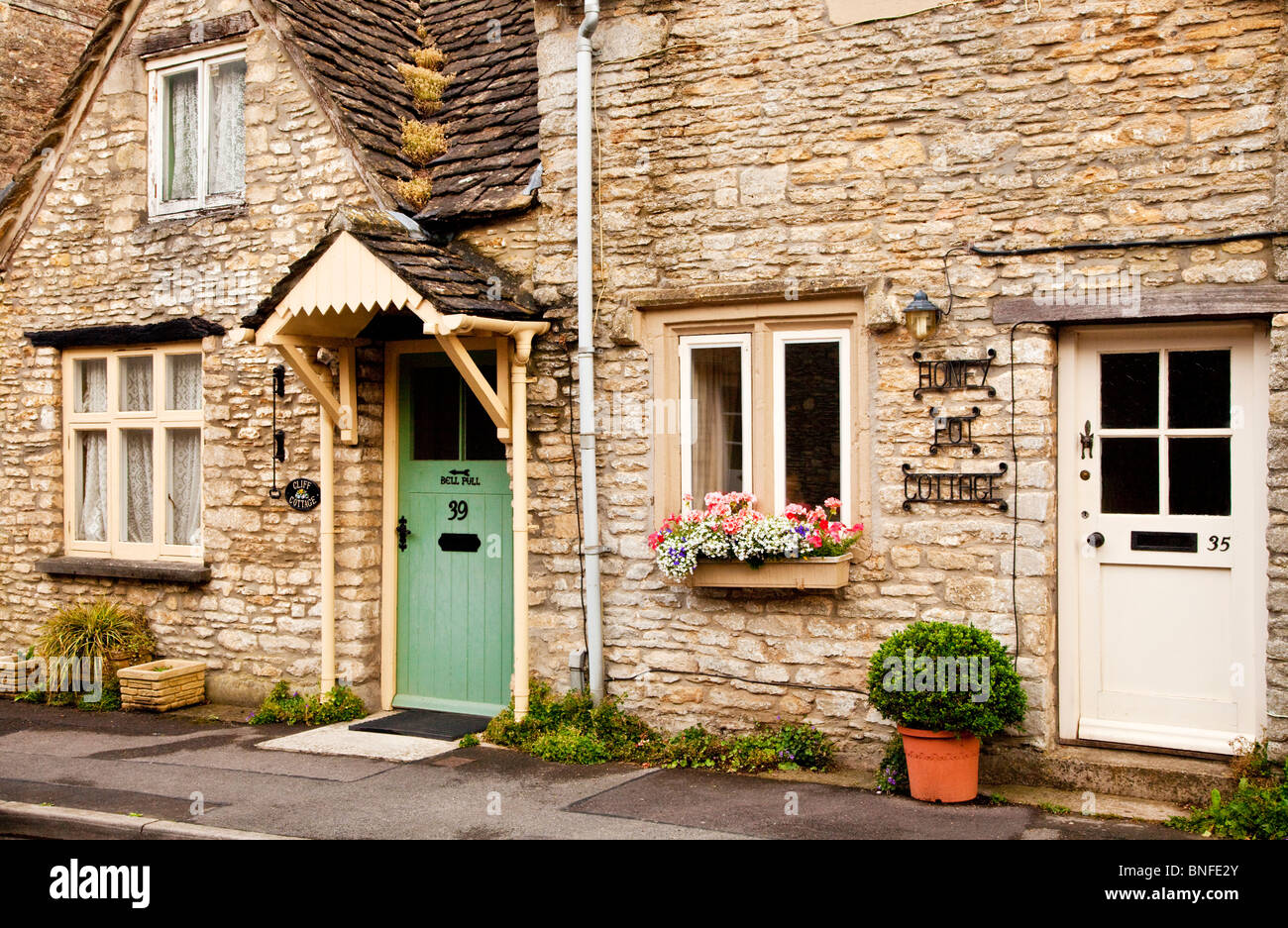 Typical quaint Cotswold stone cottages in Sherston village, Wiltshire, England, UK - Stock Image