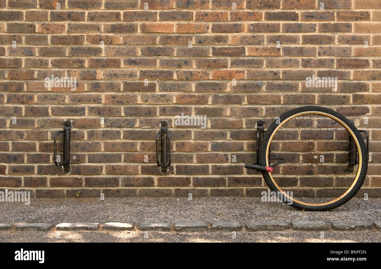 Insecure bike racks such as these at the University of Cambridge result in bicycles often being stolen minus a front - Stock Image