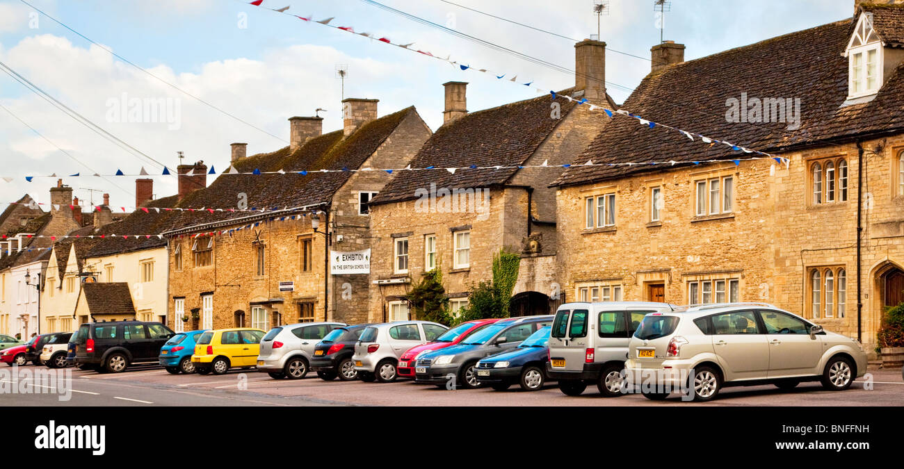 Old Cotswold stone houses along the High Street in the Wiltshire village of Sherston, England, UK - Stock Image