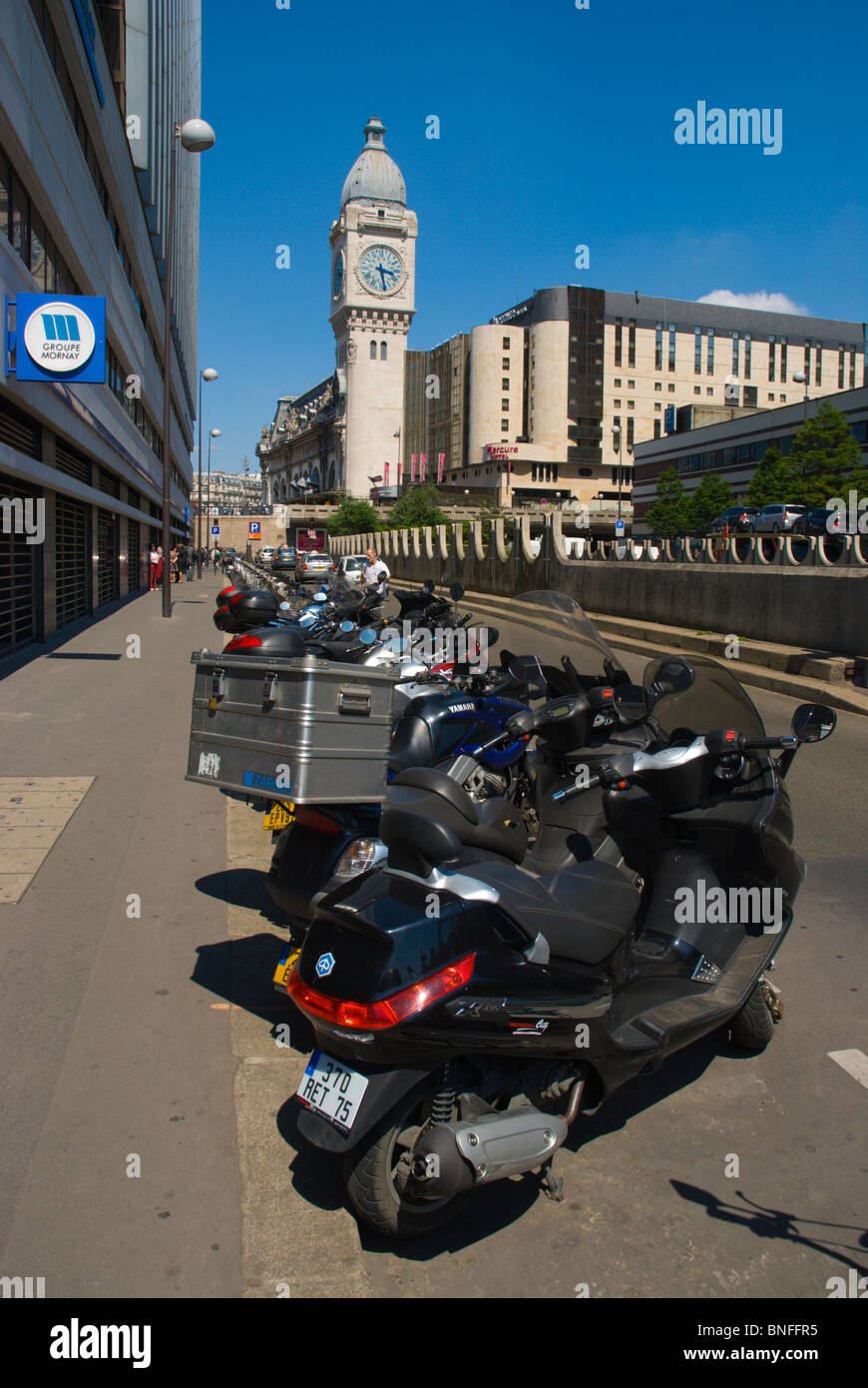 Parked mopeds scooters and motorbikes Bercy district central Paris France Europe - Stock Image