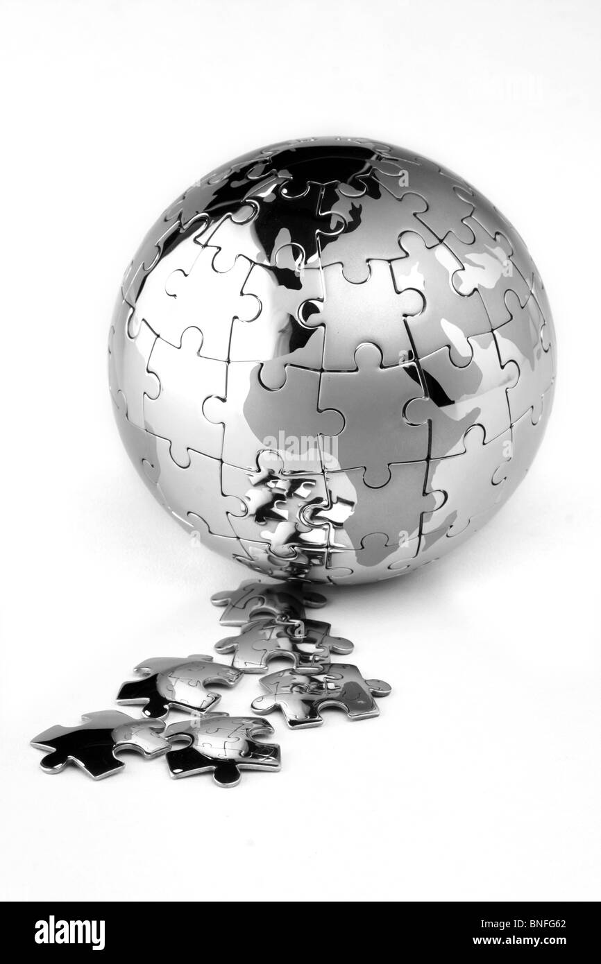 Globe puzzle on white - Stock Image