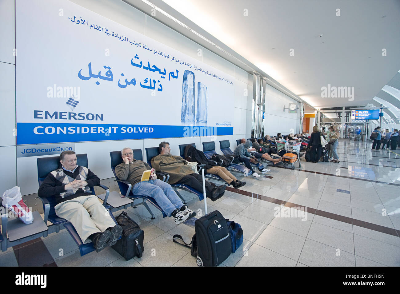 Brilliant Travellers Resting On Reclining Chairs At Dubai Onthecornerstone Fun Painted Chair Ideas Images Onthecornerstoneorg