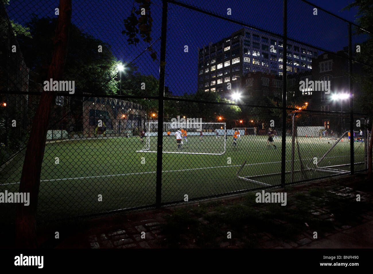 soccer football game in New York City at night - Stock Image