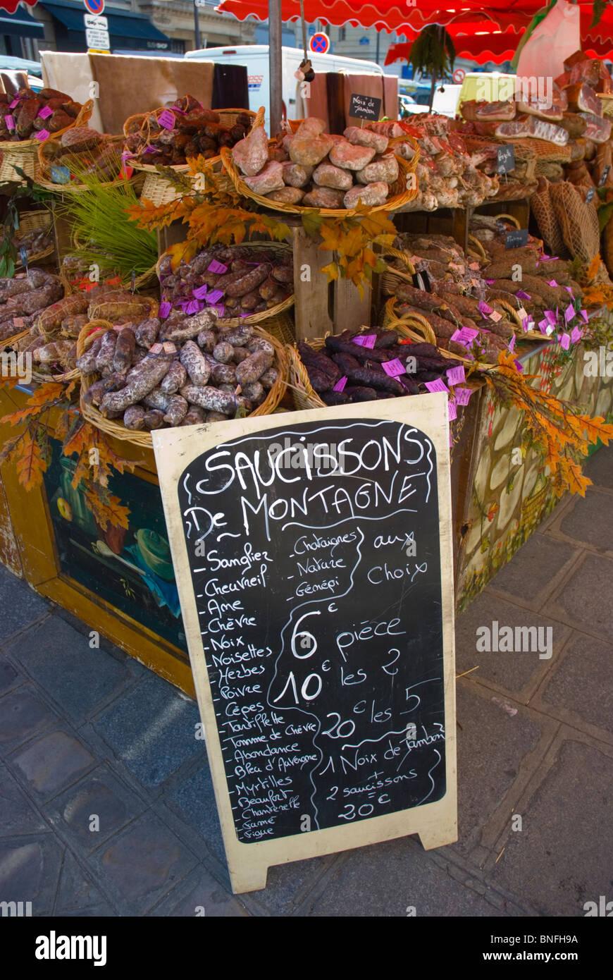 Sausage stall at Marche Parmentier street market along Boulevard Richard Lenoir Paris France Europe - Stock Image