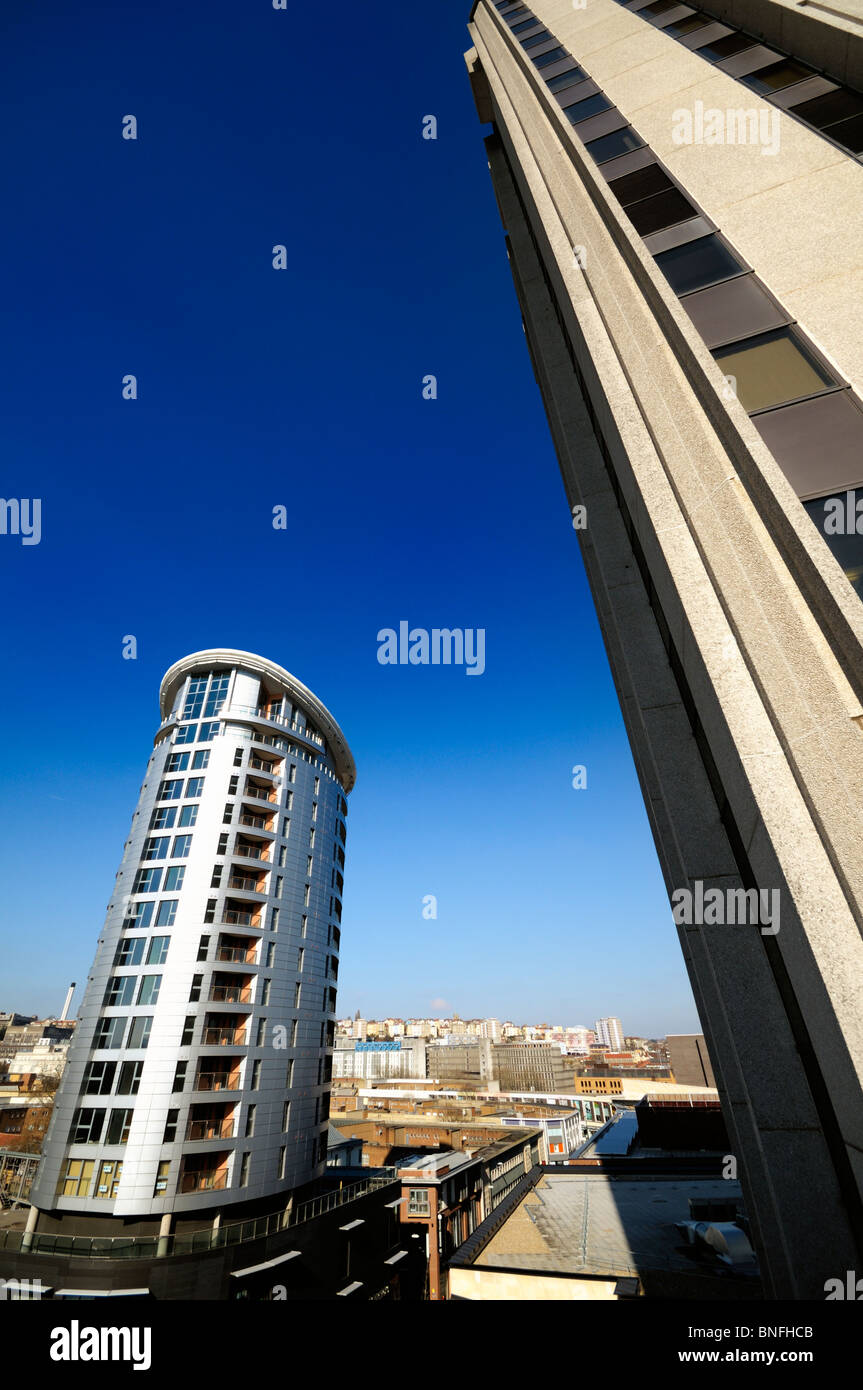 Modern multistory buildings in a British city with vibrant blue sky and picture distortion for effect. - Stock Image