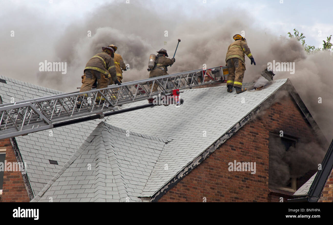 Detroit Firefighters Battle Fire in Vacant House - Stock Image