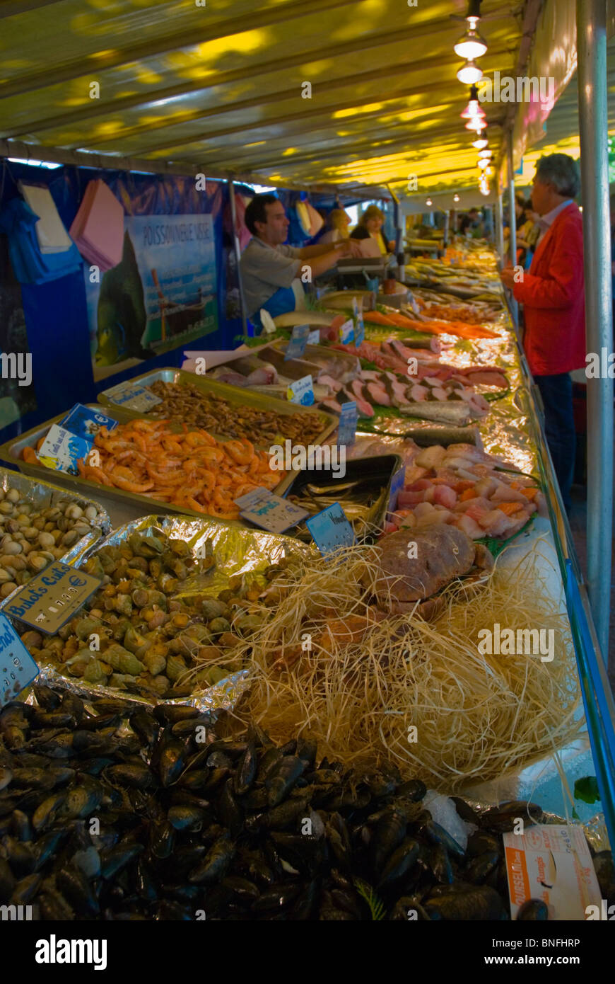 Seafood stall at Marche Parmentier street market along Boulevard Richard Lenoir Paris France Europe - Stock Image
