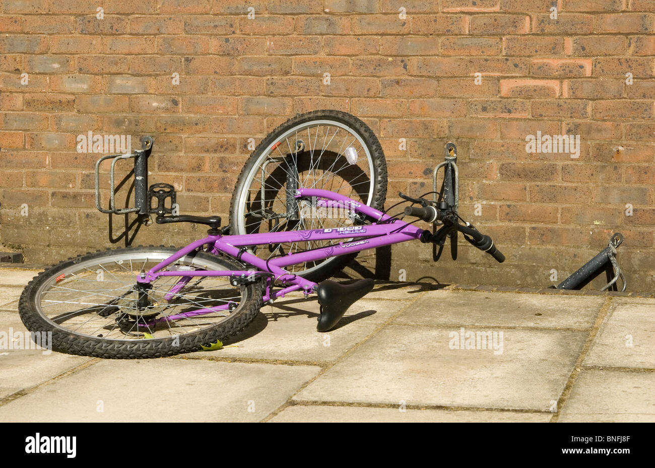 A fallen bicycle is a common sight in Cambridge in areas where butterfly stands have been installed - Stock Image