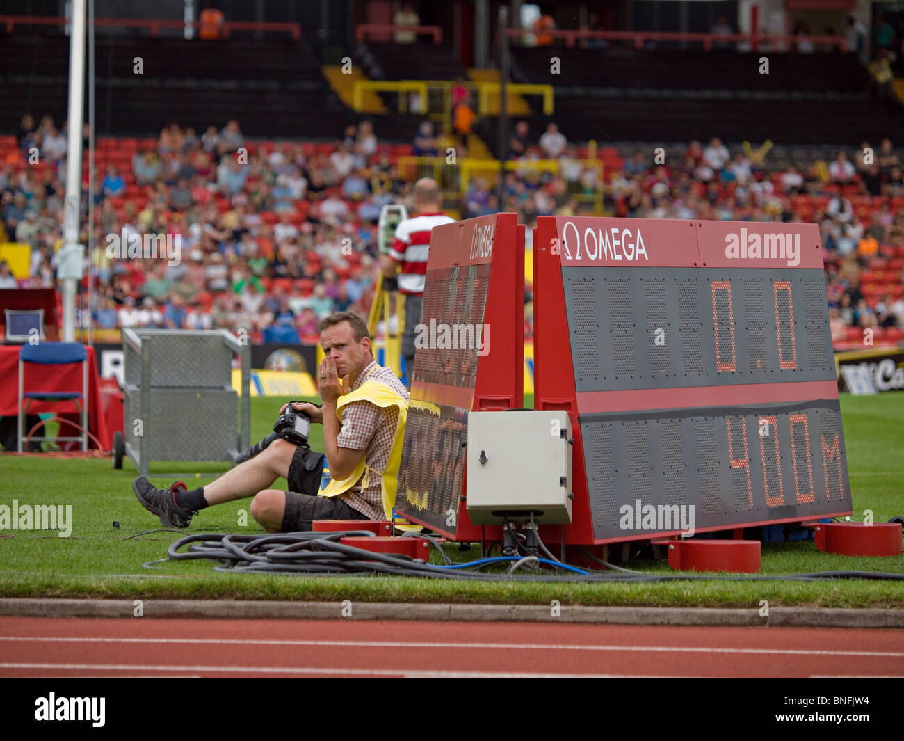 A photographer at work at the IAAF Diamond League in Gateshead - Stock Image