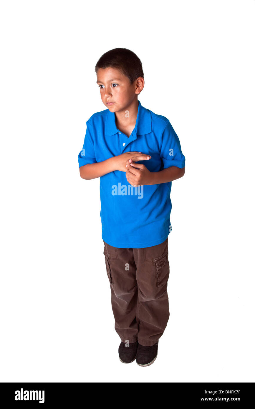 Hispanic boy 8-10 year old standing and waiting. POV United States MR  © Myrleen Pearson - Stock Image