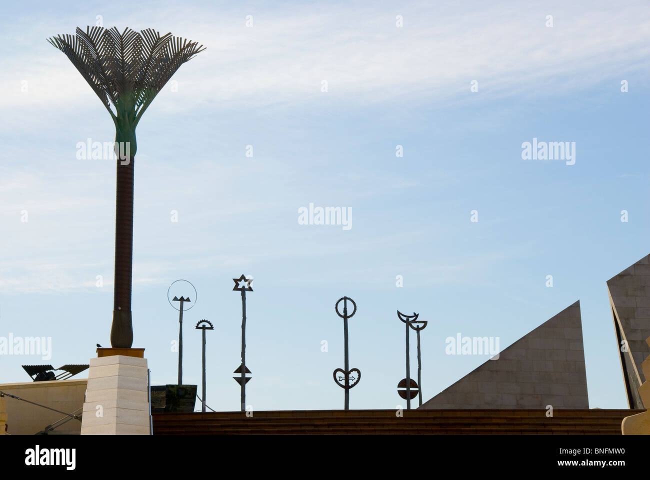 Art works on poles and artificial palm tree, Civic Square, Wellington, North island, New Zealand - Stock Image
