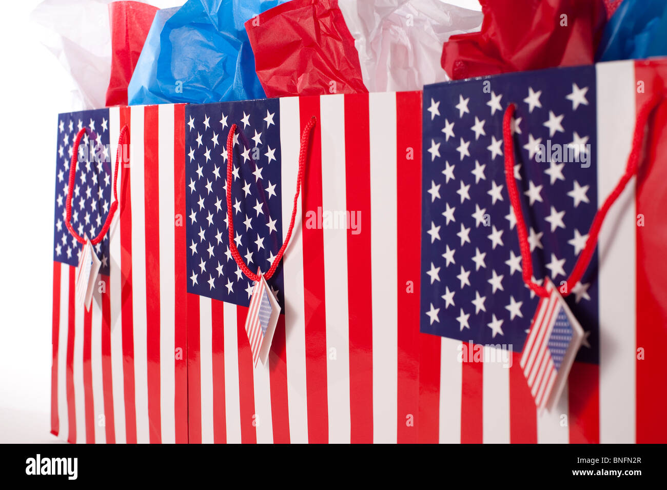 Shopping American Flag gift bags with red,white and blue tissue - Stock Image