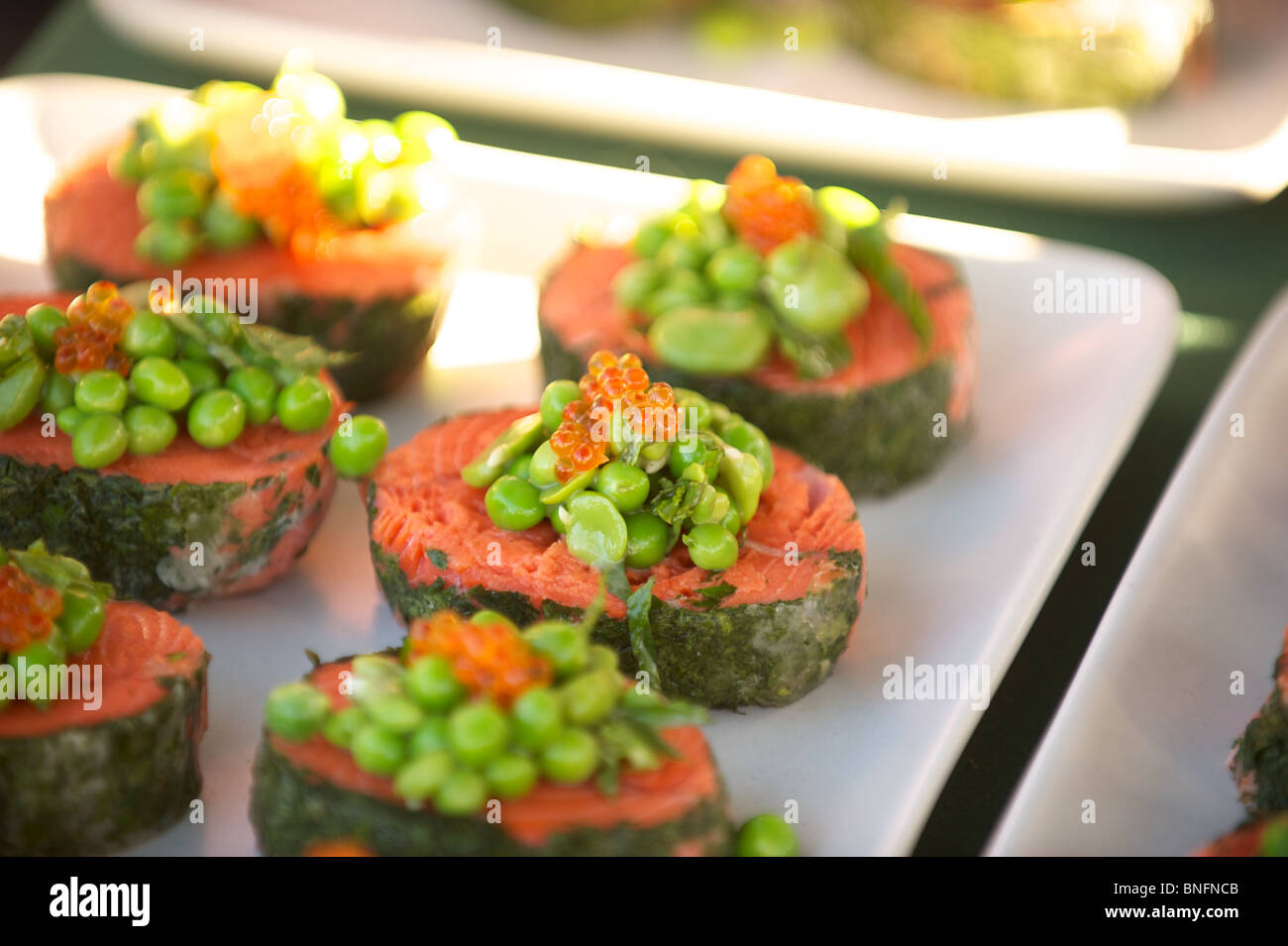 Salmon with peas and caviar. Outstanding in the Field. Pemberton BC, Canada - Stock Image