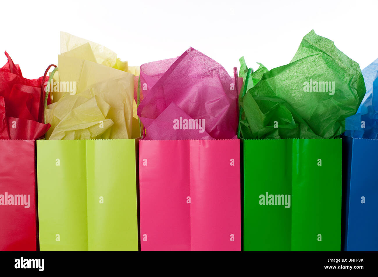 MultiColored Gift Bags with colorful tissue studio image - Stock Image