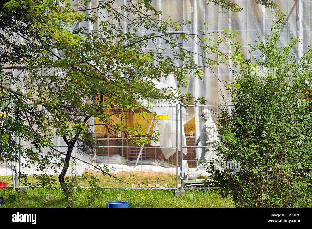 man and nature asbest Asbestos disposal dumping cleaning disposing removal full inherited waste polluted areas protective Stock Photo