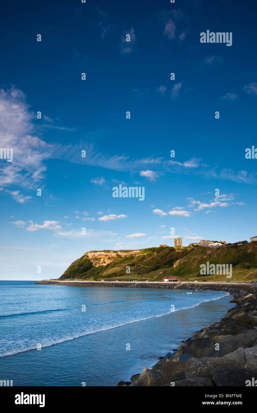 Coastal sweep on Scarborough North Bay showing Sea Defences and dramatic lighting - Stock Image